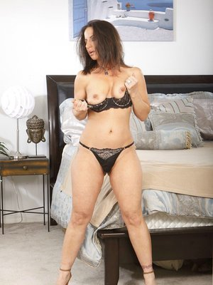 Mature lady with big ass Melissa Monet gets rid of her dress and lingerie