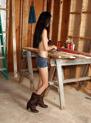 Skinny teenage cutie stripping and teasing her shaved gash