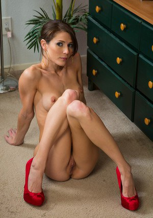 Skinny MILF with long legs Jenni Lee slipping off her dress and lingerie