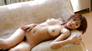 Seductive asian cutie with shapely breasts stripping off her clothes