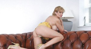 Sexy mature lady with long legs slowly stripping off her clothes