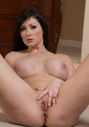 Attractive brunette with big tits Sara Hide stripping down