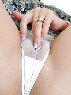Leggy mature shrew taking off her panties and rubbing her clit