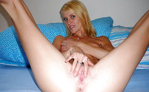 Skinny blonde amateur taking off her underwear and spreading her legs