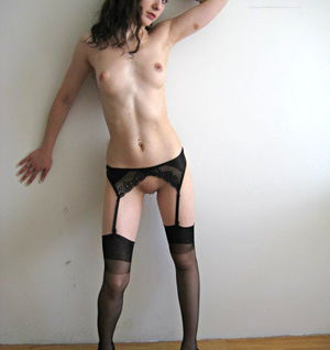 Tempting amateur in stockings slipping off her dress and panties