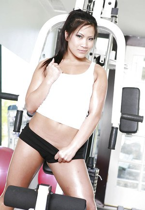 Sexy asian babe in sport outfit Christina Aguchi demonstrating her goods