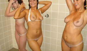 Naughty chicks have threesome lesbian fun while taking shower