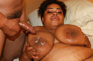 Ebony plumper Madame Trixie gets fucked and takes a cumshot on her jugs