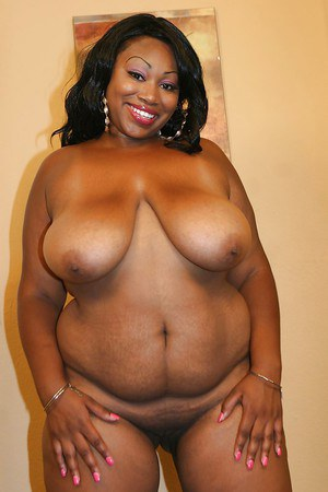 Smiley ebony plumper on high heels Yum Yum getting naked