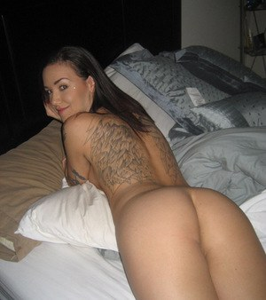 Tattooed brunette sweetie with small tits slipping off her lingerie