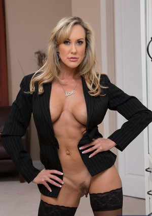 Mature lady in stockings Brandi Love stripping and spreading her legs