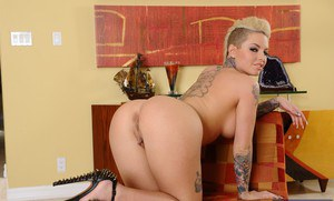 Tattooed vixen Christy Mack stripping and spreading her legs