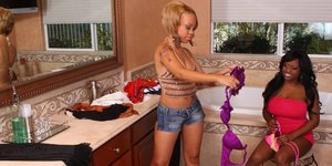 Ebony ladies have some clothes changing fun turning into lesbian action
