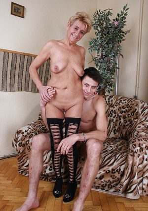 Slutty granny in stockings has some hardcore fun with a younger lad