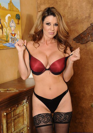 Chesty MILF Raquel DeVine taking off her lingerie and teasing her slit