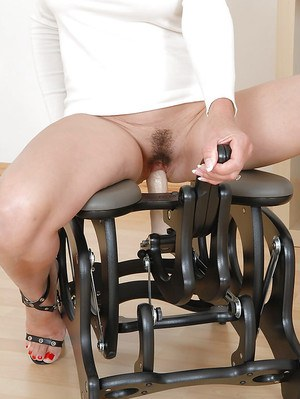 Bottomless mature vixen in glasses has a joy ride on a fucking chair