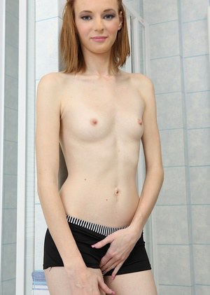 Mona Twist getting naked and teasing her shaved slit with her fingers