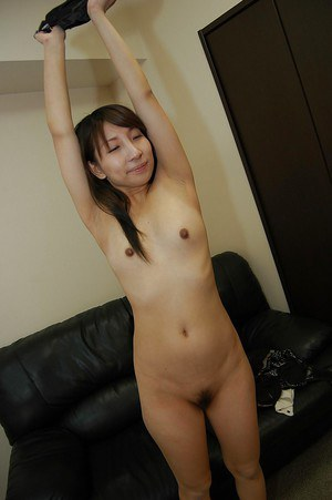 Asian babe Mai Toda exposing her unshaved cunt and playing with a vibrator