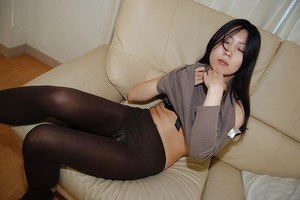 Asian teen Yui Nakazato stripping down and exposing her soaking cunt
