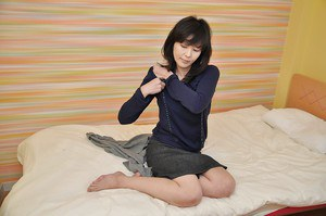 Sassy asian lady with hairy cooter getting rid of her clothes on the bed