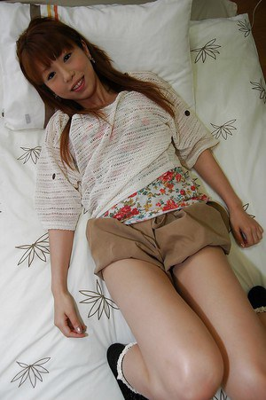 Frisky asian teen Chihiro Ozawa getting naked and spreading her pussy lis