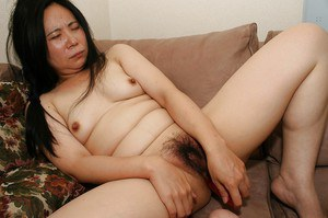 Fatty asian lady Yasuko Watanabe pleasing her hairy cunt with sex toys