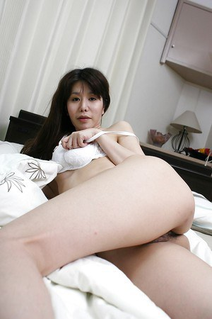 Naughty asian babe Sumie Takai getting naked and toying her hairy twat