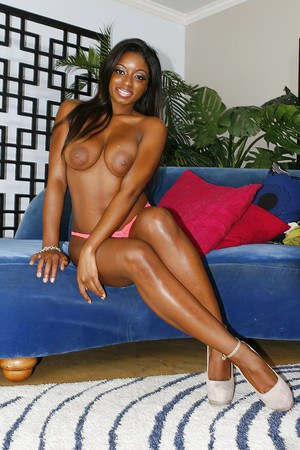 Busty ebony gal Tatiana Hope taking off her panties and spreading her legs