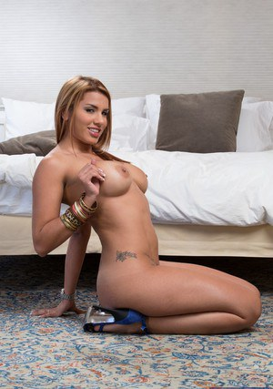 Sassy latina babe Anita Toro uncovering her gorgeous curves