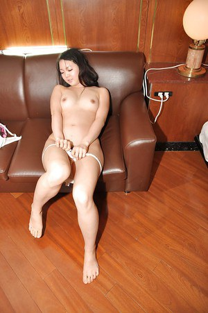 Mina Terashima strips down and gets her hairy pussy teased with a vibrator