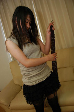 Free-and-easy asian chick Chiaki Kakitani stripping and spreading her legs