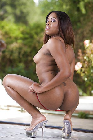 Fuckable ebony babe Danni Dior slipping off her lingerie outdoor