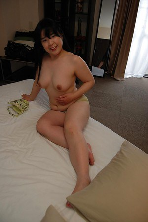 Asian MILF strips down and gets her hairy cunt pleased by vibrator
