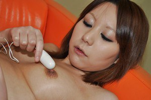 Aoi Fukasawa getting naked and teasing her nipples with a vibrator