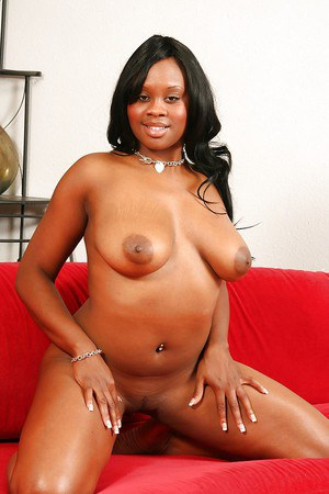 Curvaceous ebony lassie with massive melons stripping and caressing herself