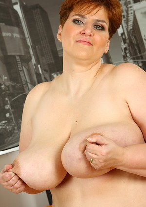 Lusty mature plumper taking off her lingerie and playing with her giant jugs