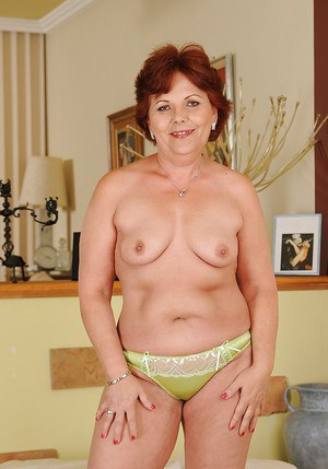 Fatty granny with saggy tits undressing and playing with a big dildo
