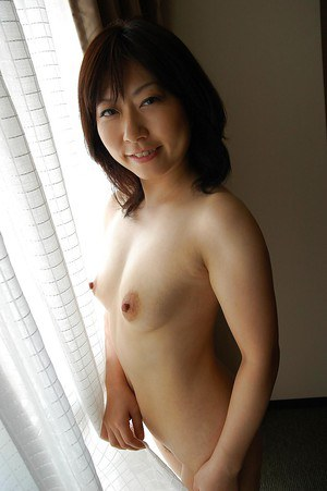 Saucy asian MILF strips down and gets her twat pleased with a vibrator