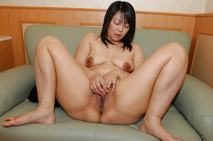 Chubby asian MILF Rumi Yasumoto undressing and toying her love holes