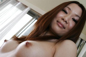 Asian babe with hairy gash Nozomi Onodera undressing and spreading her legs