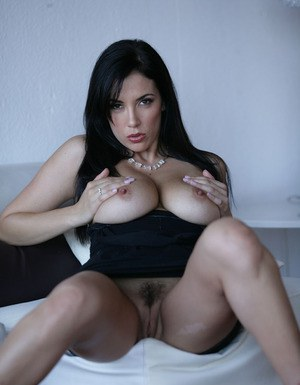 Foxy brunette with smoky eyes revealing her big tits and trimmed cooter