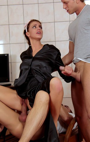 Naughty hottie enjoys a partly clothed threesome with studly lads