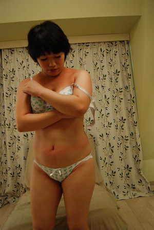 Asian lady Akiko Kano undressing and exposing her trimmed gash in close up