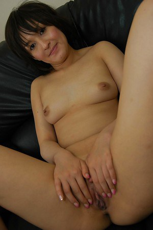 Dirty-minded asian MILF Seiko Kuramoto undressing on the bed
