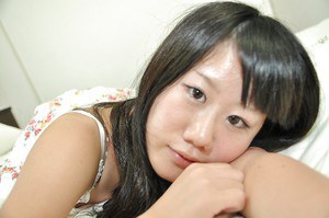 Asian teen takes off her panties and gets her shaved vag pleased with toys