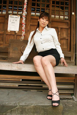 Asian mature lady in dress clothes revealing her ample bosoms outdoor