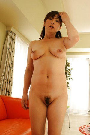 Asian mature lady Nozomi Oshima undressing and exposing her twat in close up