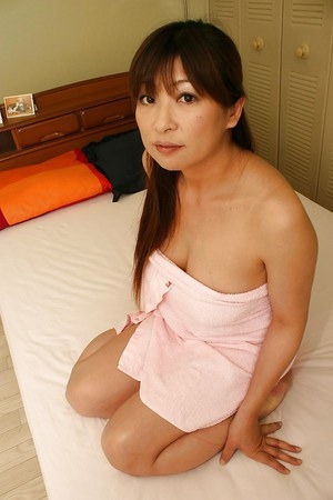 Asian mature gal Nozomi Oshima posing naked and playing with her sex toys