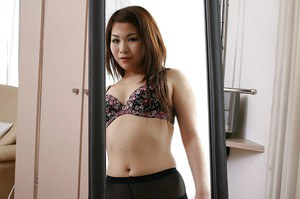 Lovely asian MILF Satoko Suda slowly uncovering her svelte curves