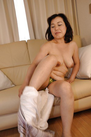 Asian MILF Junko Morikawa undressing and masturbating her unshaven cunt